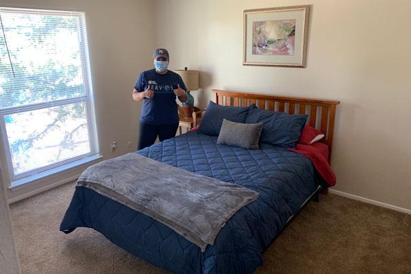 volunteer sets up bedroom