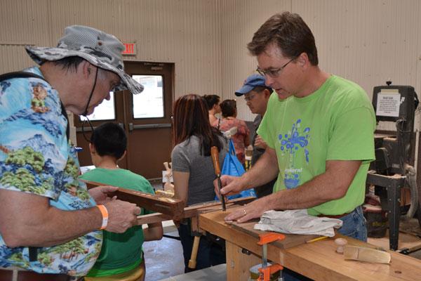 Aaron Hall demonstrates wood working technique