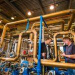 researchers investigate a turbine and compressor