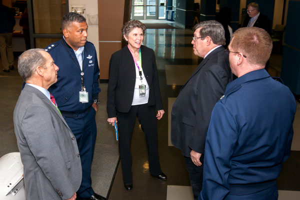 Air Force officers and Sandia executives in conversation