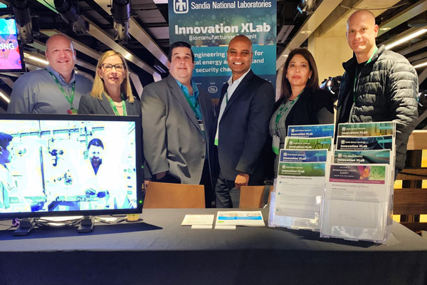 researchers are Sandia XLab booth