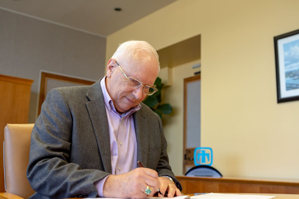 Steve Younger signs assessment letter