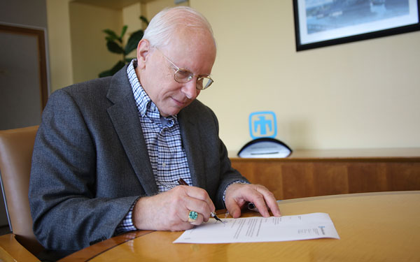 Labs Director Steve Younger signs annual assessment letter