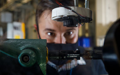Close-up of researcher working on arc-fault generator