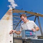 scientist positions monitor on bridge