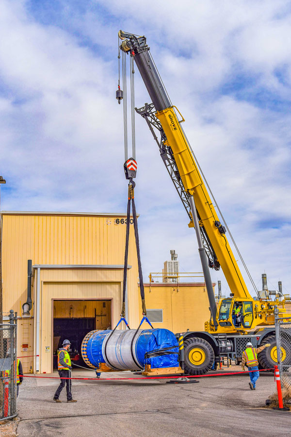 giant steel canister being lifted by crane