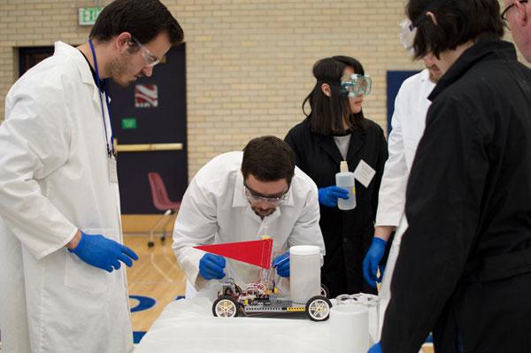 team members work on chem-e-car