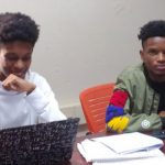 cyber interns work on laptops