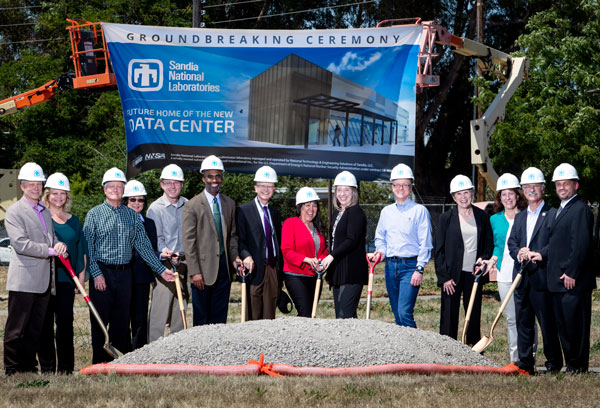 leadership poses with shovels at new data center site