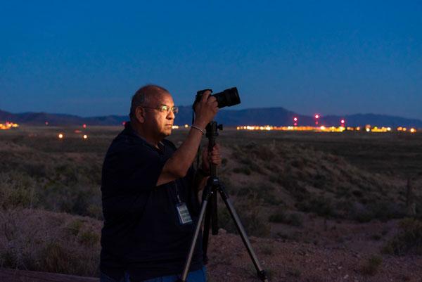 Sandia photojournalist Randy Montoya works with his camera