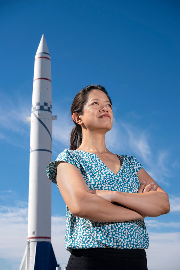 Frances Chance poses with missile in background