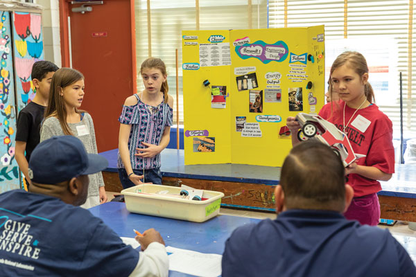 students give presentation to judges