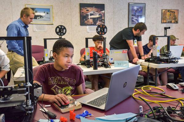 teens working on computers