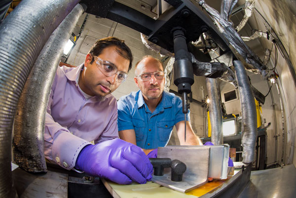 scientists work on battery materials