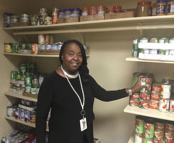 Bev McMillan checks the snack pantry