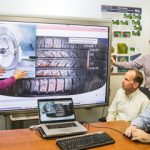 Sandia computer scientists and Goodyear engineers study images of tire technology