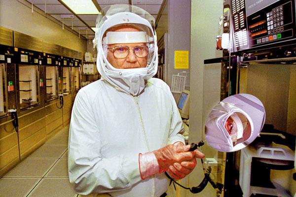 Willis Whitfield in hazmat suit in lab
