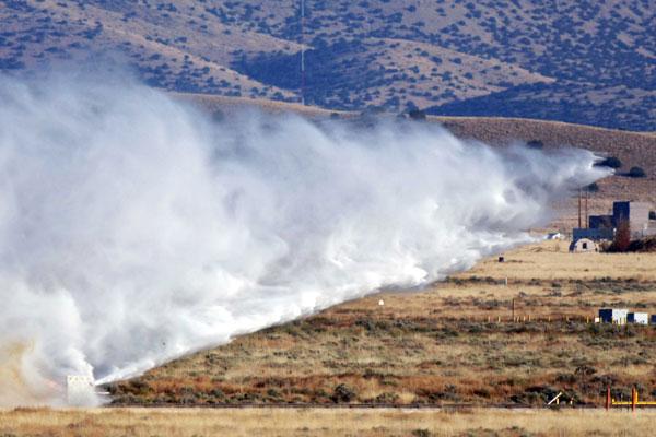 huge cloud of dust follows test unit along sled track