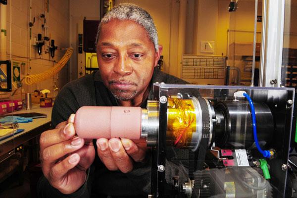 Moses Jones examines equipment in lab