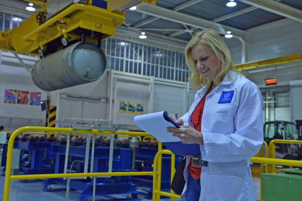 IAEA inspector checks list in nuclear facility