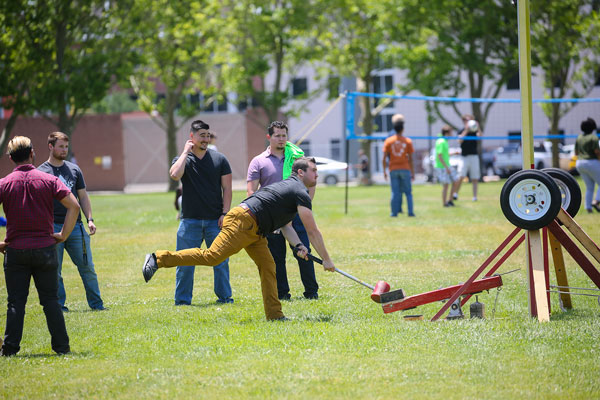 students compete in hammer game