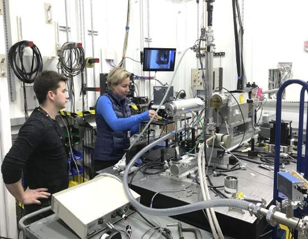 scientists set up experiment in photon lab