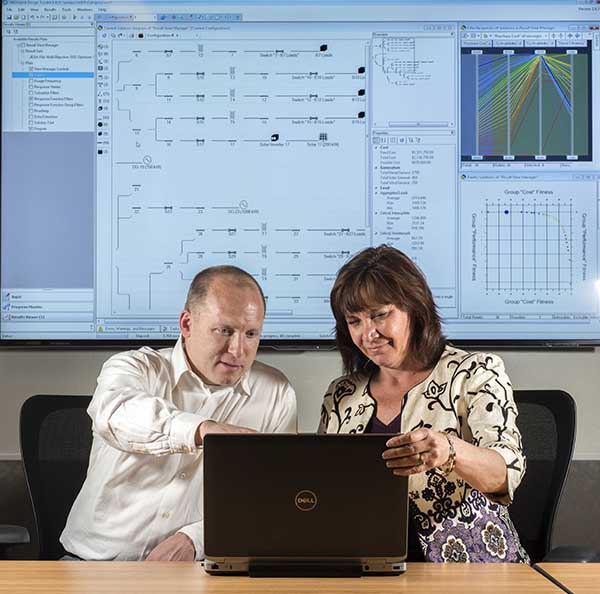 Sandia researchers Nadine Miner and John Eddy are collaborating with the US Marine Corps to help it make smart decisions on renewable energy planning with a powerful software tool called MDT, the Microgrid Design Toolkit.   (Photo by Randy Montoya)