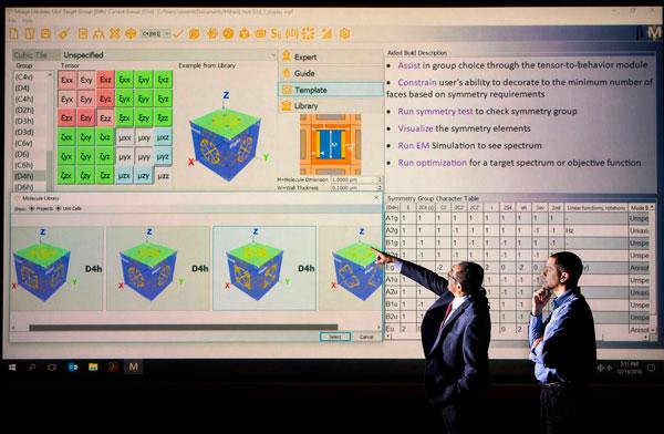 scientists look over sample mirage screen