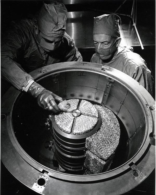 scientists inspect moon lander equipment