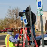 Facilities staff replace accessible parking signs
