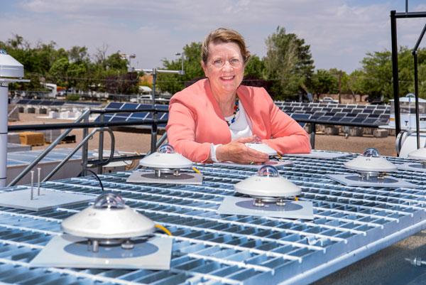 Laurie Burnham in solar panel field