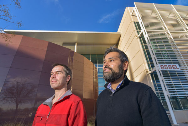 Peter Maunz and Ojas Parekh standing in front of Sandia facility
