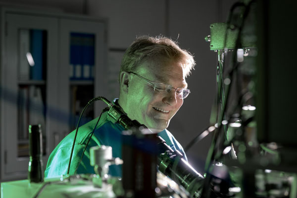 Ed Bielejec examines a material at the Ion Beam Laboratory