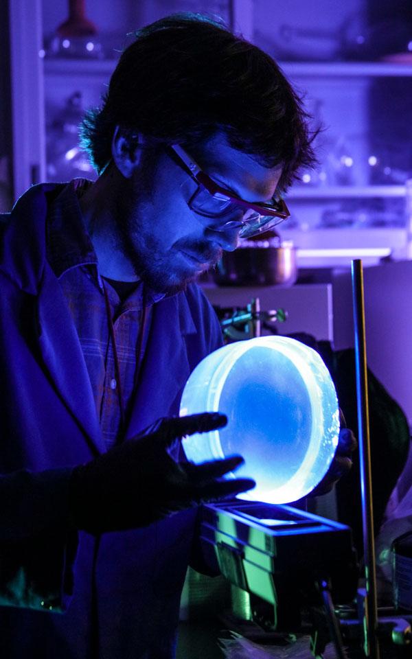 scientist inspects anti-fog radiation detecting plastic