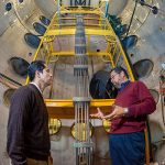 Sandia's Tito Bonano shares his knowledge on energy research with Efrain O'Neill, electrical engineering professor