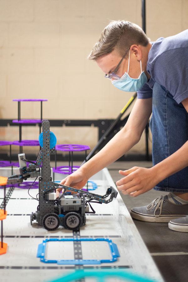 kid works on robot
