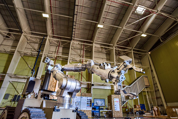 A robot maneuvers through obstacles