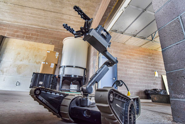 A robot maneuvers through a Sandia training facility