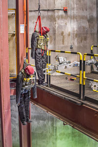A robot completes a challenge that involves mannequins hanging with mock explosives