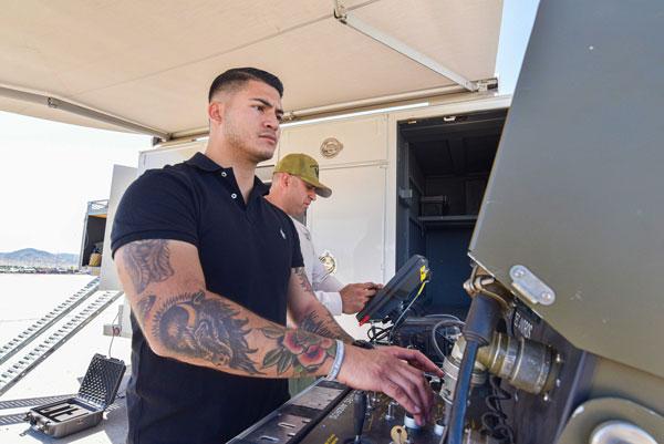 Staff Sgt. Michael Marquez worths through one of the bomb squad scenarios