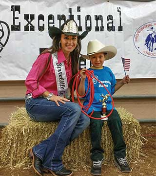 Caption SANDIA TECHNICAL INTERN Cami Belcher (1853) and an Exceptional Rodeo cowboy share a moment at the New Mexico State Fair Sept. 15, 2015. Cami loves the Exceptional Rodeo — a mini rodeo for children with special needs.(Photo courtesy of Cami Belcher)