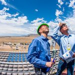 Cliff Ho and Sen. Martin Heinrich on top of the solar tower