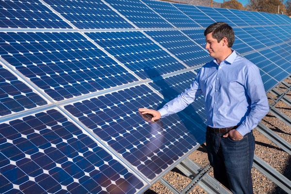 engineer inspects solar panels