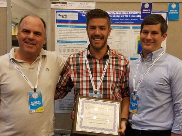 engineering team poses with award certificate