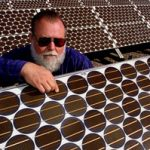 In a 1994 file photo, Jack Cannon inspects photovoltaic cells