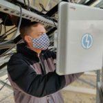 Dan Riley checks the Wattch monitoring enclosure