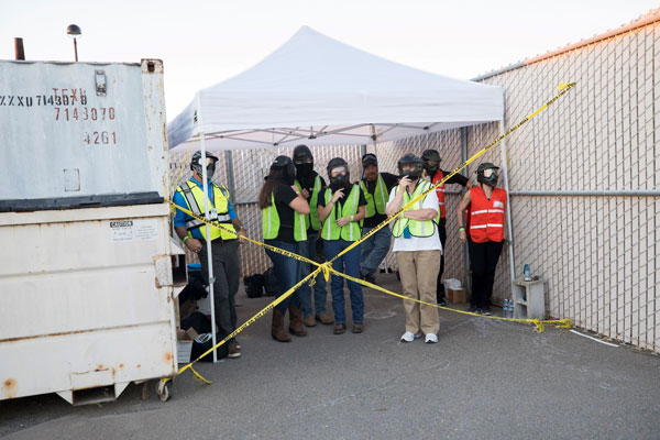Exercise observers stand in the safe zone.
