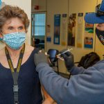 Deputy Labs Director Dori Ellis receives a COVID-19 vaccine
