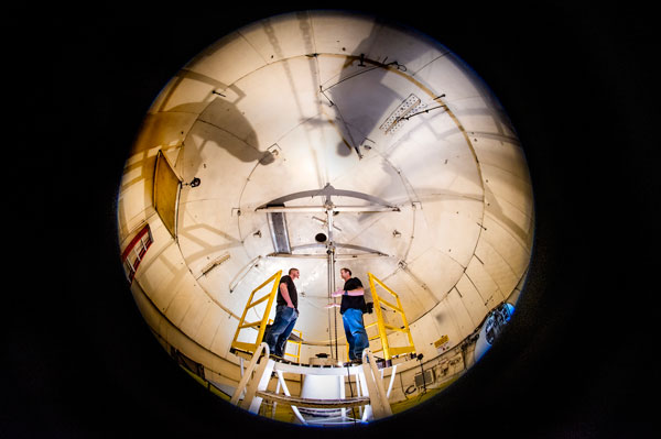 technologists discuss test installation in the high altitude chamber
