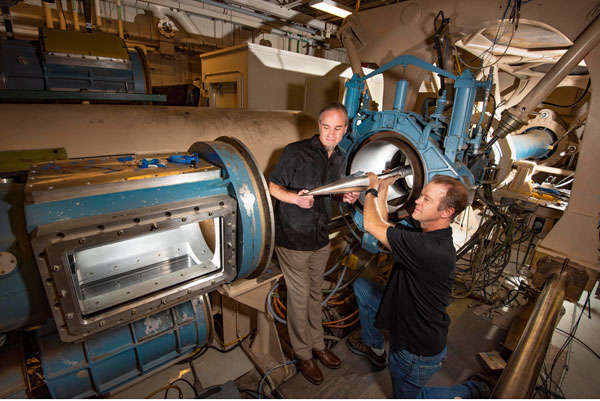 Sandia aerosciencists place a model in the hypersonic wind tunnel's test section